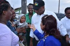 Minister of State, Mr. Joseph Harmon and Minister of Public Affairs, Mrs. Dawn Hastings-Williams sharing a light moment with this young resident of Liverpool village, during their walkabout yesterday.