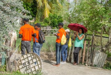 VERT participants interact with residents as they conduct a transect walk.
