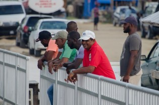 Residents overlooking the boat landing at Supenaam.