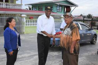 Minister of State, Mr. Joseph Harmon and Minister of Public Affairs, Mrs. Dawn Hastings-Williams sharing a light moment with Mr. Imtiaz Bacchus, a resident of Albion.
