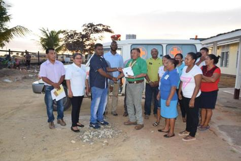 Minister of Indigenous Peoples' Affairs, Sydney Allicock and Regional Executive Officer, Carl Parker during the handing over of the ambulance to the Aishalton District Hospital.