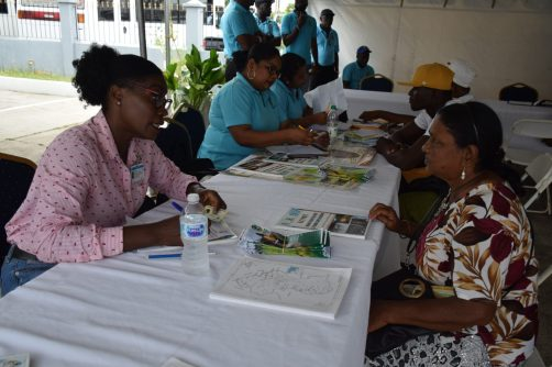 Residents gathered at the Ministry of Communities booth at UG, Tain Campus, Berbice.