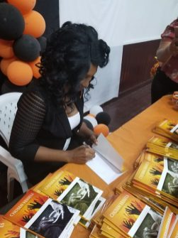 Author, Wendy Natasha Fraser autographing books at her book launch.