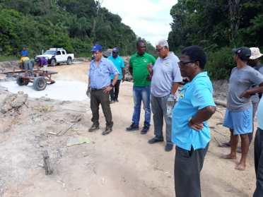 Inspecting road improvement works at Ebini