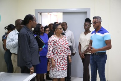 The team from the ministry of Public Health as they toured the Port Mourant facility.