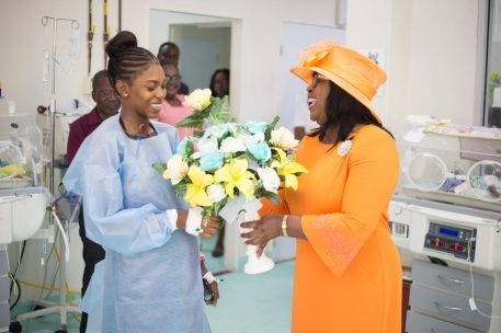 Mother of the triplets, Latifa Stephen with Minister within the Ministry of Public Health, Dr. Karen Cummings who extended a congratulatory token on behalf of the ministry