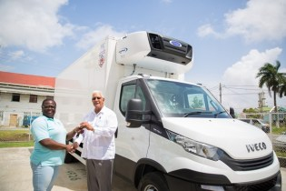Minister of Agriculture, Noel Holder hands over the keys to the new truck to General Manager of the Guyana Marketing Corporation (GMC), Ida Sealy-Adams.