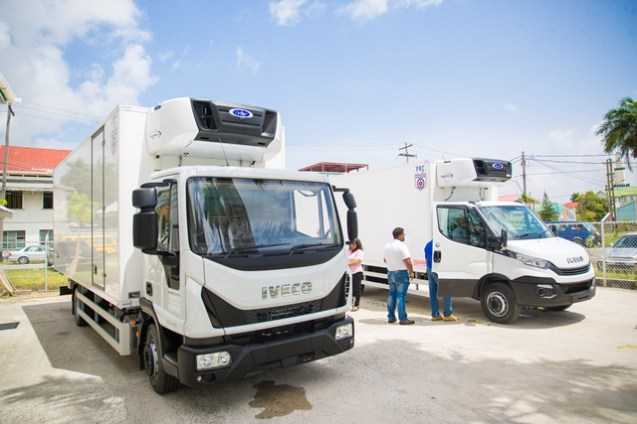 The two new refrigerated trucks donated by the Ministry of Agriculture.