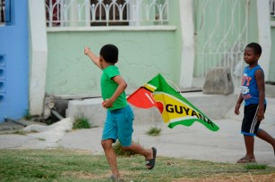 One of the children getting his kite up.