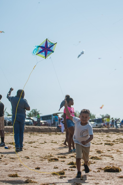 Youngster flying a kite.