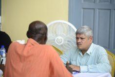 Junior Finance Minister Jaipaul Sharma listens to a resident