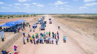 Overhead shot of the ministerial team shortly after the ribbon was cut to officially open the Manari bypass.