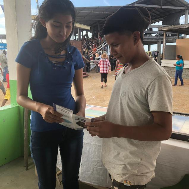One of the peer educators, Dennize Mithekhozer engages a young man who visited the booths and was interested in the use of a male condom