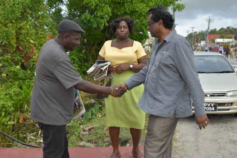 Minister of Public Security Khemraj Ramjattan greeting residents of Central Mahaicony during a walk-about