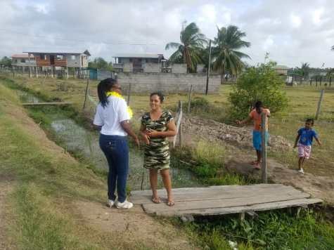 West Berbice resident, Nafeeza Persaud chats with Minister designate Tabitha Sarabo-Halley