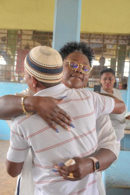 Minister Simona Broomes embraces one of the young inmates at the Timheri Prison during her Mother Day