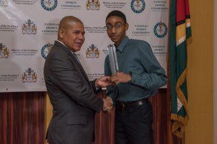 Junior Sportsman of the year - Shomari Wiltshire receiving his award from Minister of Social Cohesion with responsibility for Culture, Youth and Sport, Dr. George Norton.