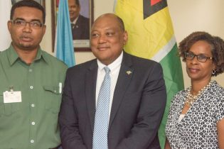 Minister of Natural Resources, Raphael Trotman [centre] with FAO Representative in Guyana, Dr. Gillian Smith and Mr. Kenny David, Head, FLEGT Secretariat
