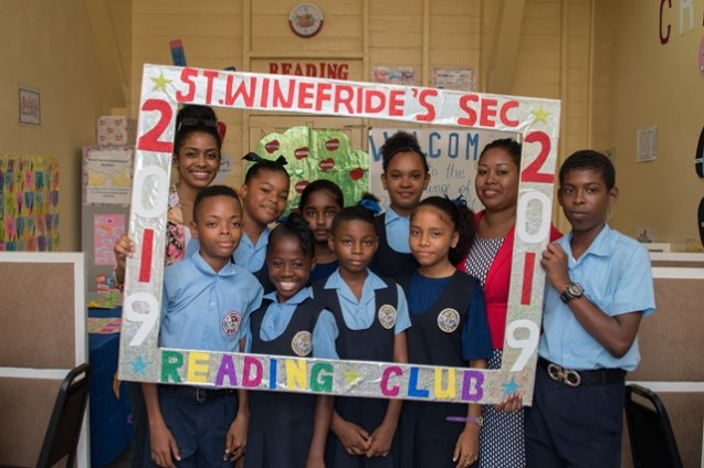 Students of St Winefride pose with teachers at their New Reading Club.