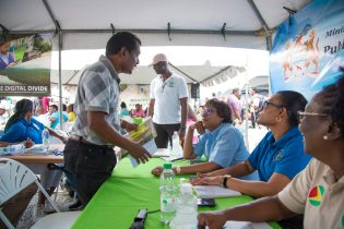 Minister of Public Telecommunications, Catherine Hughes interacts with concerned residents
