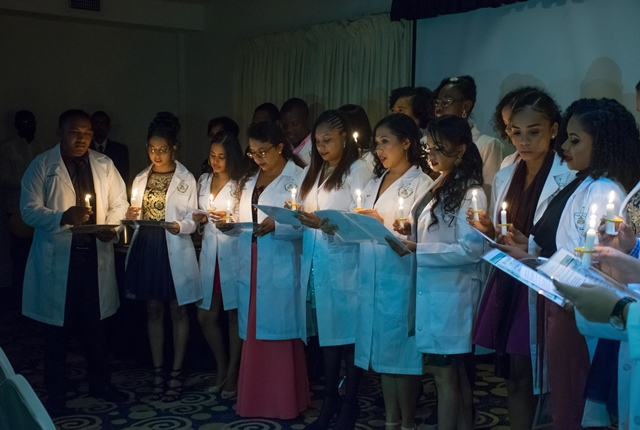 The new Pharmacists as they recite the Pharmacist's oath