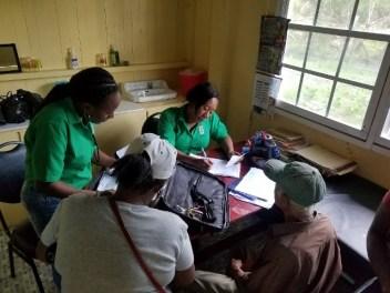 General Registrar Office officers in green facilitating the registration of births at Fort Island.