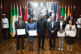 Newly sworn-in Minister of Business, Haimraj Rajkumar, reassigned Minister, Dr Karen Cummings who now holds the portfolio of Minister of Foreign Affairs, President David Granger, Prime Minister Moses Nagamootoo, newly sworn-in Minister of Public Service, Tabitha Sarabo-Halley and reassigned Minister Dawn Hastings-Williams, who now holds the portfolio of Minister of State.
