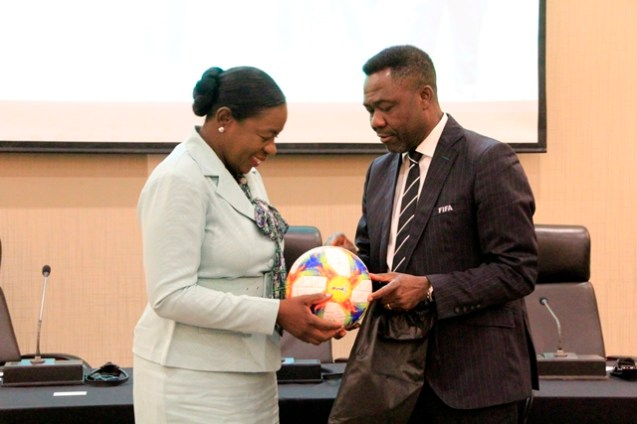 The official ball for the FIFA 2019 Women's World Cup being presented to Minister Henry by FIFA Member Association and Development Director, Mr. Veron Mosgengo-Omba (Ministry of Education photo)
