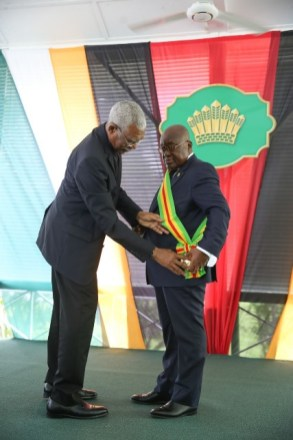 HE President David Granger bestowing Guyana's Highest National Award, The Order of Excellence upon HE Nana Akufo-Addo, President of the Republic of Ghana.