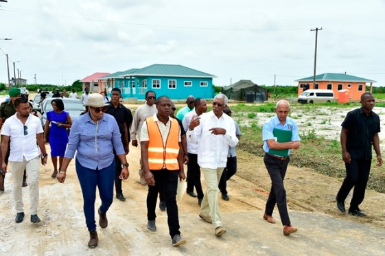 President David Granger along with Minister of Communities, Ronald Bulkan and Minister within the Ministry of Communities, with responsibility for Housing, Annette Ferguson as they visit the housing schemes.
