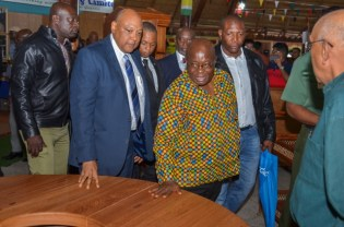 Ghanaian President, His Excellency Nana Akufo-Addo accompanied by Minister of Natural Resources, Raphael Trotman inspects some of Guyana's wood products.