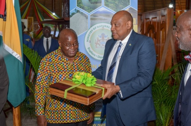 Minister of Natural Resources, Raphael Trotman presents Ghanaian President, His Excellency Nana Akufo-Addo with a token of appreciation.