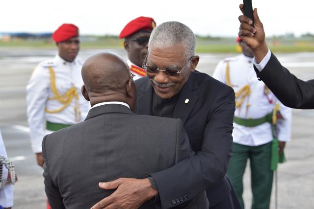 President David Granger embraces President of the Republic of Ghana, Nana Akufo-Addo as he prepares to depart Guyana.