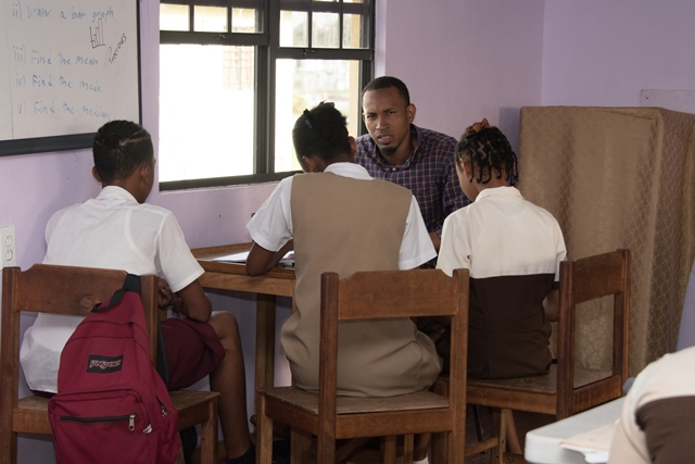 Teacher and students at the Ruimveldt Life Improvement Centre.