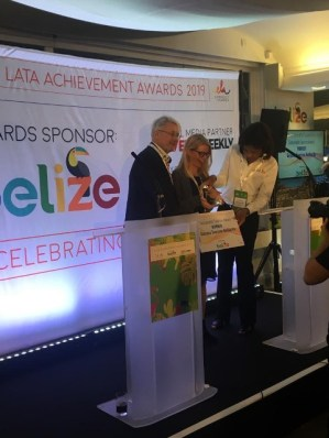 UK Market Rep, Kate McWilliams of Lotus UK, receiving the award on Guyana's behalf