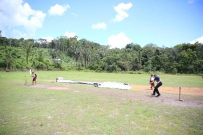 Min Rajkumar plays cricket with schoolboys.