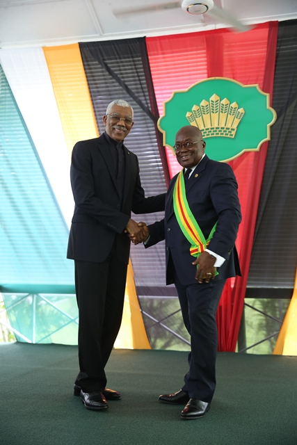 President of the Republic of Ghana, Nana Akufo-Addo is congratulated by President David Granger after receiving The Order of Excellence.