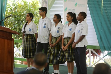 Students from Marian's Academy reciting a poem.