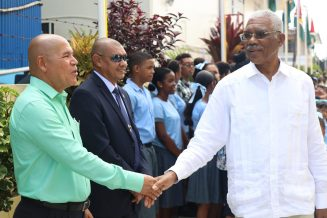 Minister of Social Cohesion, Dr. George Norton greets President David Granger at the opening of the ninth Cabinet hosted in Bartica Region 7