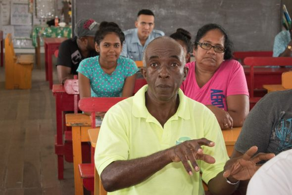 A Sans Souci resident engaging the ministers