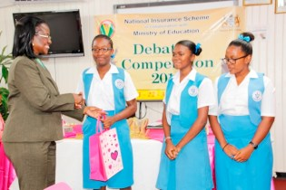 The students of St. Joseph's High School receiving their prizes as winners of the debating competition (Ministry of Education photo)
