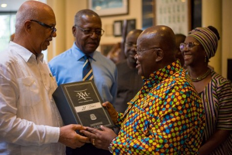 Chairman, Banks DIH, Clifford Reis, and Vice Chairman George Mc Donald present a vintage special blended 21-year XM Rum to the President of the Republic of Ghana Nana Akufo-Addo.