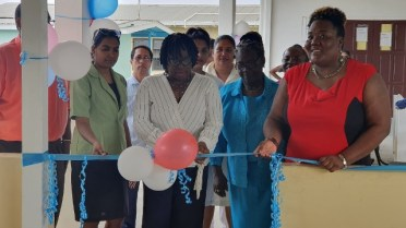 Regional Executive Officer Jennifer Ferreira Dougall cutting the ribbon to commission the new health centre