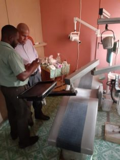 Minister Norton and Dr. Reynold Daniels examine Kuru Kururu only Dentist clinic owned by Dr. Reynold Daniels and wife, Dr. Rita Daniels.