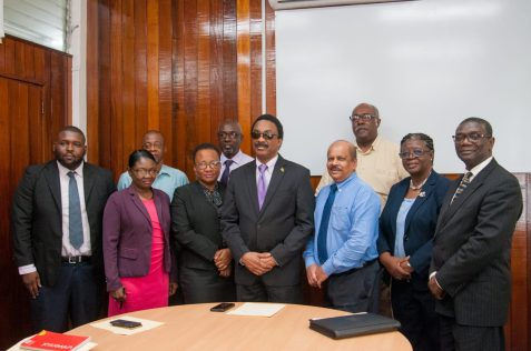 Attorney General and Minister of Legal Affairs, Hon. Basil Williams poses with heads of agencies following the signing.