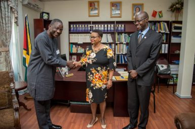 Minister of Public Health, Hon. Volda Lawrence meets with UNAIDS' incoming Director for Guyana and Suriname, Dr. Michael Gboun and his replacement, Dr. Martin Odiit