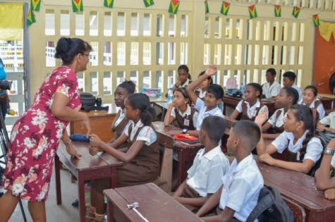 Deputy Headmistress of CV Nunes Primary School, Bindawattie Ketwaru attending to her students.