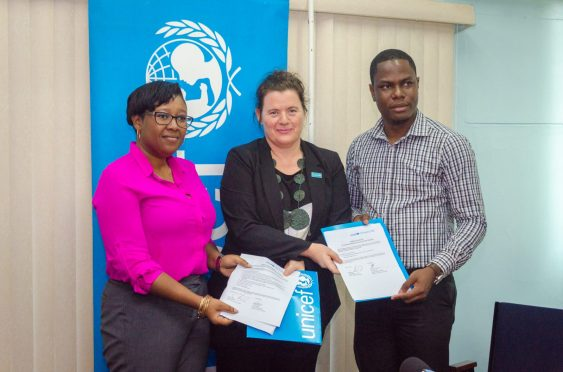 [In the photo, from left] Ministry of Social Protection representative, Tonni October, UNICEF Resident Representative to Guyana, Sylvie Fouet and Regional Health Officer (RHO) Region 4, Dr. Quacy Jones with the signed document for the donated equipment earlier in June