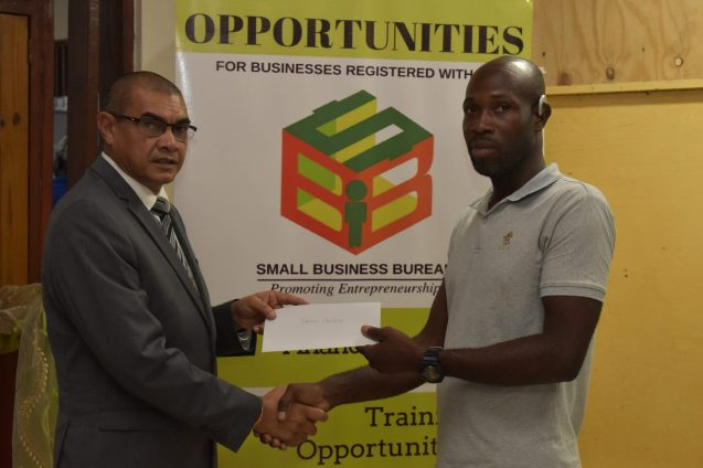 Jermaine Crawford receives his SBB grant from Business Minister, Hon. Haimraj Rajkumar