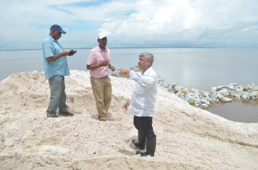 Minister within the Ministry of Public Infrastructure, Hon. Jaipaul Sharma inspecting CDB project in Endeavour, Leguan.